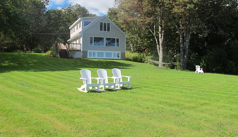 Expansive lawn leading to water