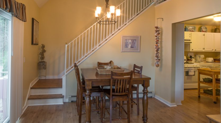 Dining area and stairs to 2nd floor