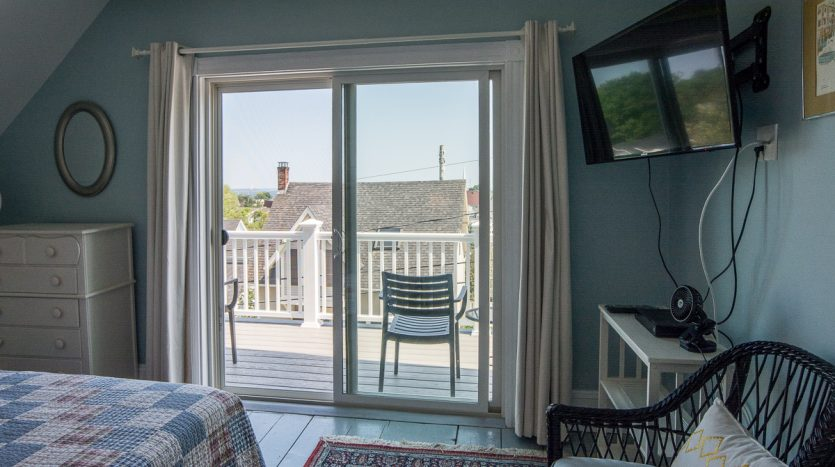Master bedroom with TV and views of village and ocean