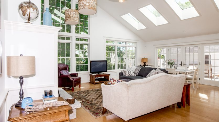 Living room with large windows and skylights