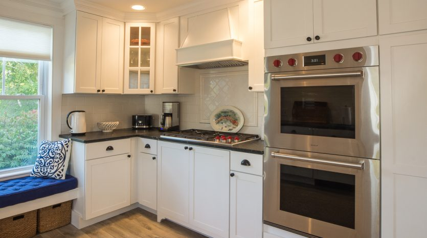 Kitchen with gas range and double ovens