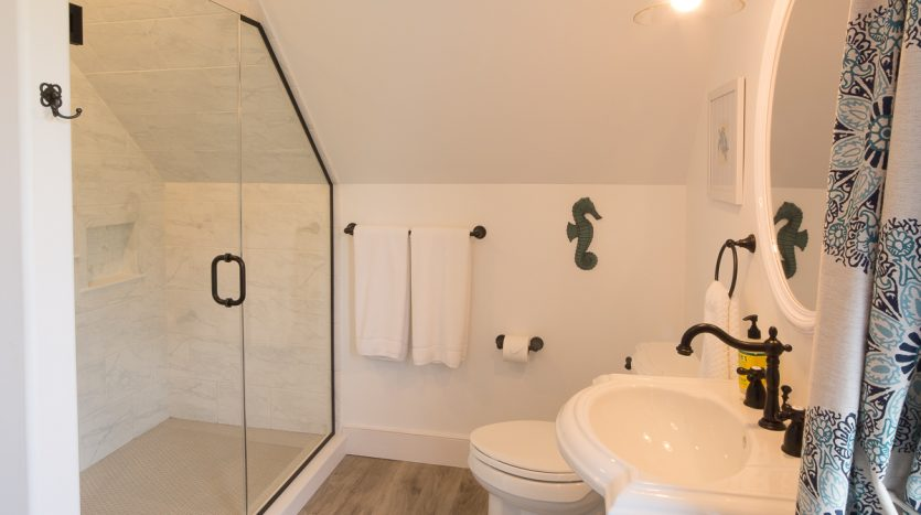 Full bathroom with shower and laundry