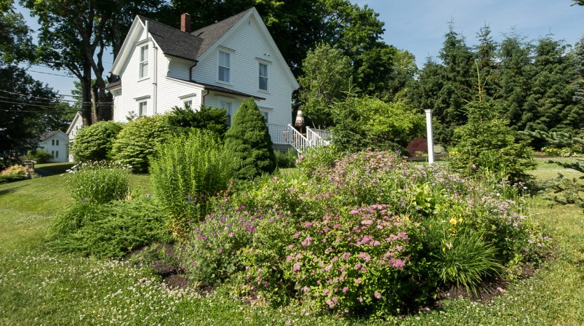 Flower beds surround the house