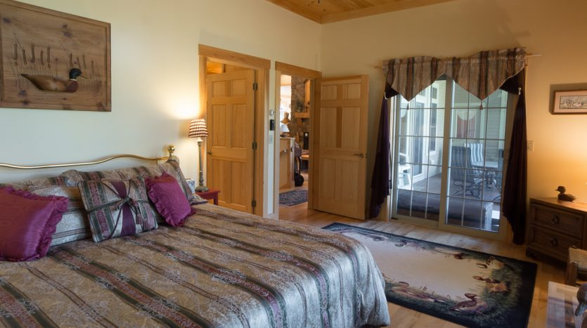 Master king bedroom with sliding doors to porch