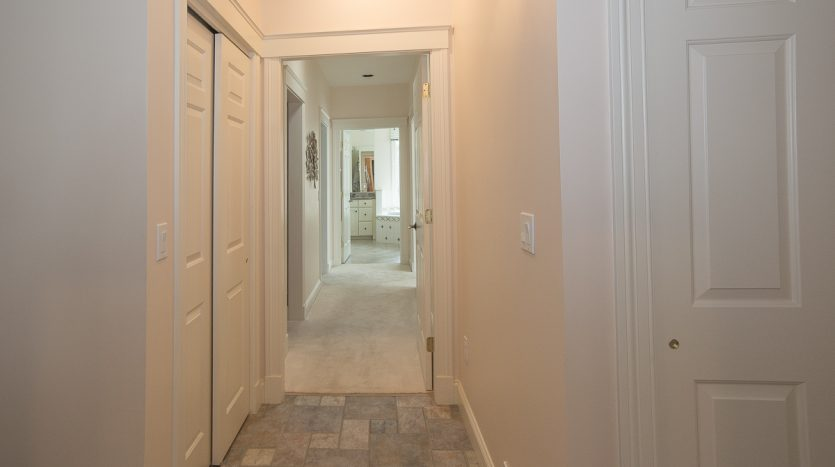 Hallway to spacious and private master suite