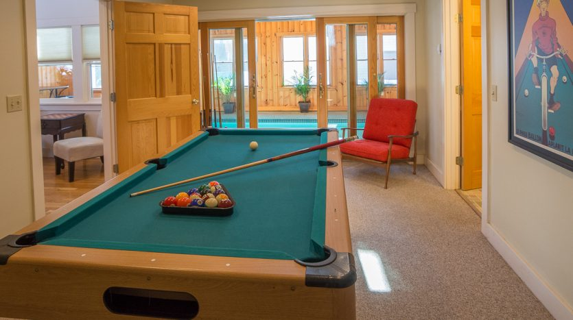 Game room and entrance to pool