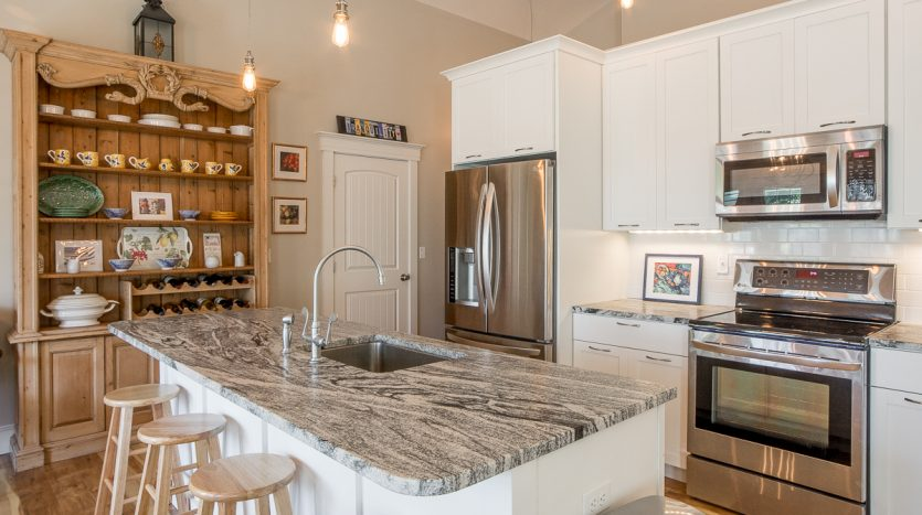 Large granite island with sink and seating