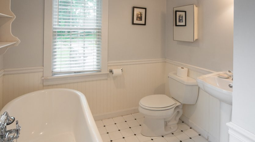 First floor bathroom with laundry and soaking tub
