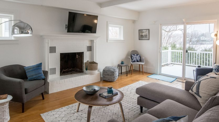 Living room with TV and views of Camden Harbor