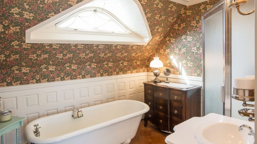 Full bathroom with soaking tub and separate shower